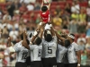 Fiji players lift the HSBC Ball boy before the Cup Final match against South Africa on day two of the HSBC World Rugby Sevens Series in Singapore on 14 April, 2019. Photo credit: Mike Lee - KLC fotos for World Rugby