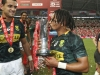 South Africa's Selvyn Davids kisses the Singapore Cup trophy after the win over Fiji on day two of the HSBC World Rugby Sevens Series in Singapore on 14 April, 2019. Photo credit: Mike Lee - KLC fotos for World Rugby