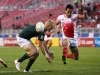 Japan's Naoki Motomura clears a ball against the South Africa defense on day one of the HSBC World Rugby Sevens Series in Las Vegas on 1 March, 2019. Photo credit: Mike Lee - KLC fotos for World Rugby