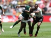 South Africa captain Siviwe Soyizwapi drives through the Fiji defense on day two of the HSBC Cape Town Sevens 2019 men's competition on 14 December, 2019. Photo credit: Mike Lee - KLC fotos for World Rugby