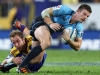mohicanos_rob-horne-waratahs-tackled-by-jimmy-cowa26
